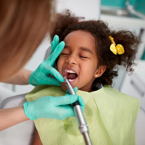 child getting their teeth cleaned at the dentist's office